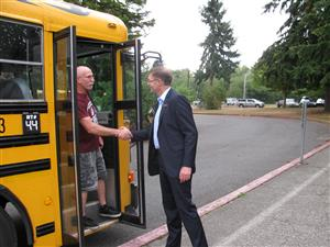 Superintendent greeting a bus driver on the first day of school