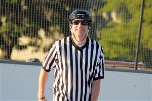 Mr. Harris reffing roller hockey