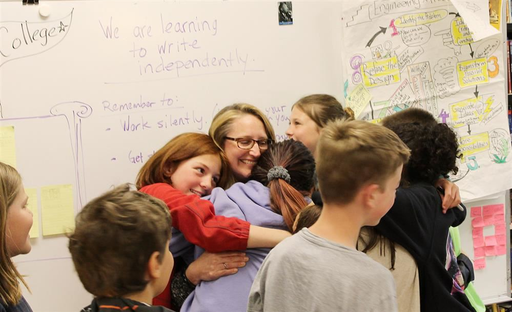 After receiving the BISD STRONG Award, Cathy Oden is flocked by a group of Odyssey students.