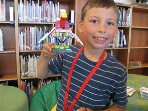 Miguel Guillen-Kushner shows off his robotic bird.